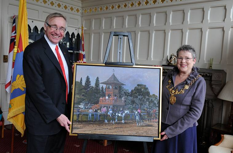 Charles Wait, Chair of the Saratoga150 Committee, and Councillor Jill Houlbrook, Lord Mayor of Chester, displaying the painting in the Lord Mayor's Parlour, Town Hall, Chester